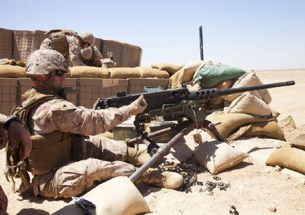 U.S. Marine Corps Cpl. Andrew C. Bell Loads Ammunition into M2 .50-Caliber Heavy Machine Gun (5177)